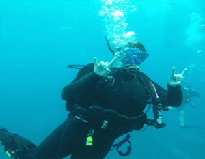 Shelby scuba diving in the tropics